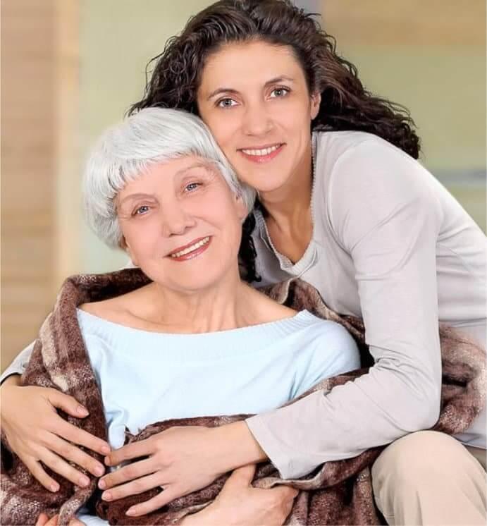 caretaker hugginng elderly