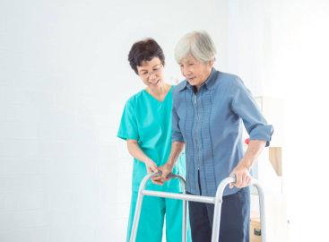 caregiver helping her patient