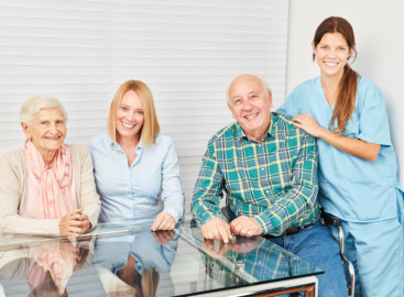 caregiver smiling along with their patients